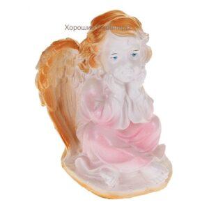 Ангел в платье сидя белый